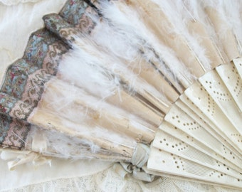 vintage folding hand fan, tattered decayed elegance, timeworn french charm. brocade trim, marabou feathers, silk satin ribbons