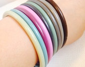 Vintage Plastic Bangle Bracelets Set of 9, Grays Pinks Blues Mint Green Brown Colors, Thin