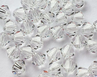 50 piece lot 5301 Swarovski 4mm Clear Crystal bicone beads
