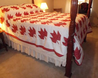 A Red Maple Leaf Quilt Top with Horseshoes  in   fabric