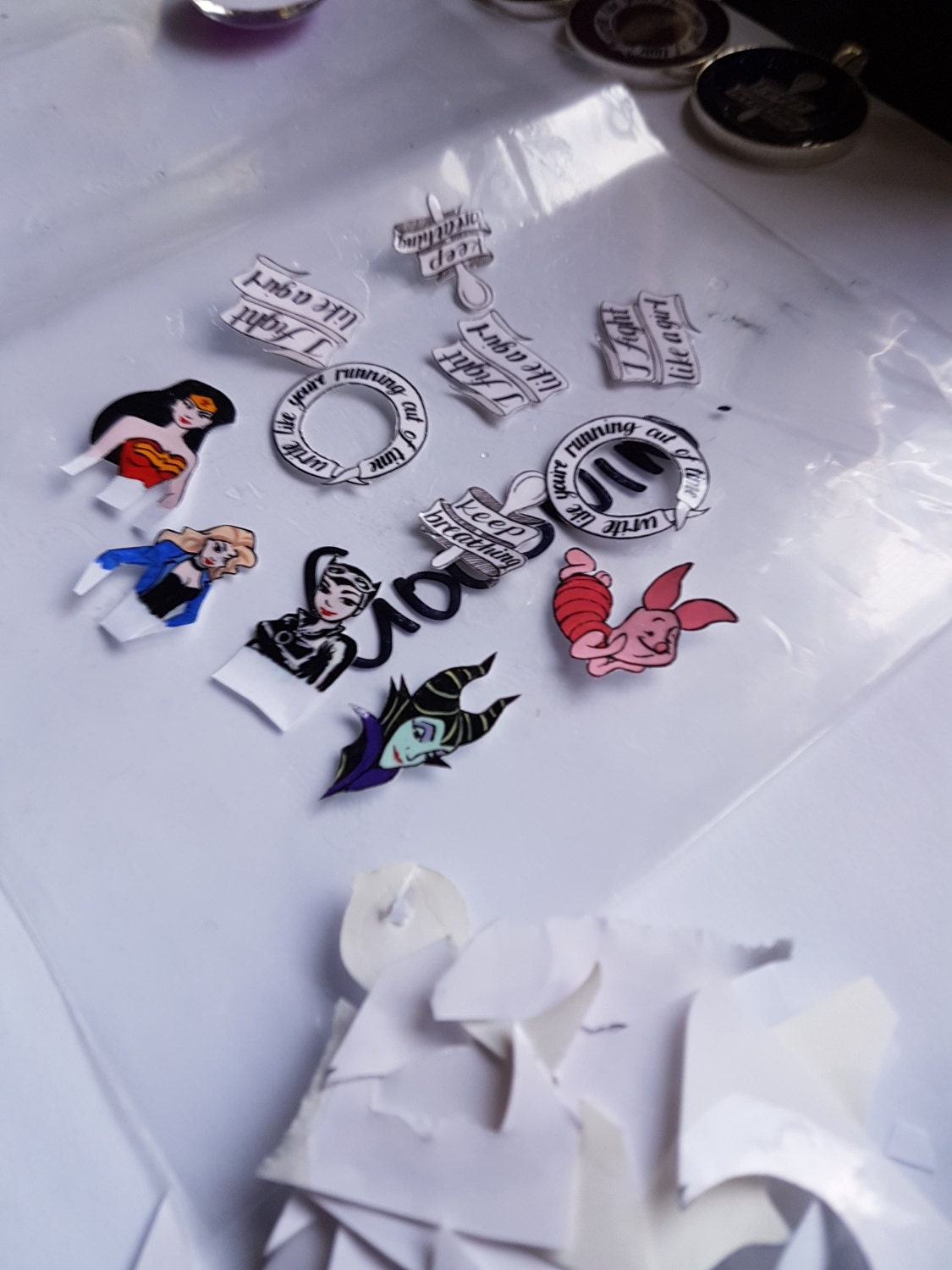 Several pieces of paper with debris from cutting them out