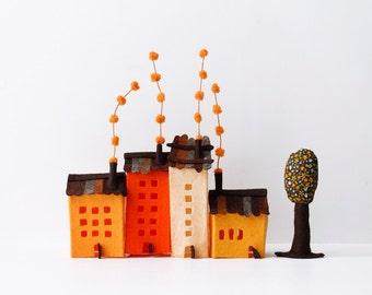 Four buildings of felt, with a tree. Miniature, Home Decoration, Urban scene, Orange tones