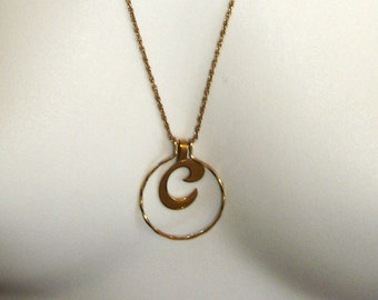 vintage AVON gold C in a circle necklace