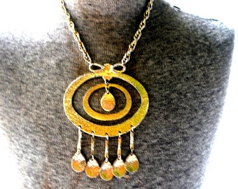 Modernist vintage 80s gold tone , hummered metal necklace with oversize, geometric figures, dangle pendant.