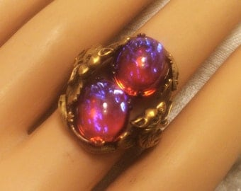 Vintage Adjustable Dragons Breath Ring with Two Stones in Setting of Dragons, Snakes, and Leaves Beautiful Blue Flashes in Deep Pink (J111)