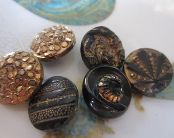 Vintage buttons, 6 assorted bronze/ gold luster over black glass, Victorian pressed designs (jan 22b)