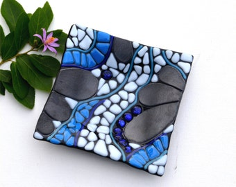 Fused glass art plate, mosaic, dichroic blue glass, black, white, blue and steel, organic.