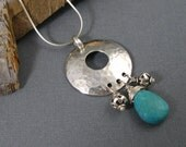 Natural turquoise and sterling silver pendant necklace on sterling hammered disc, Artisan hand forged necklace with turquoise drop