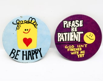 Pair of motivational badges