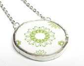 Broken plate necklace . atomic flower and spirograph design . green and yellow . 1960s