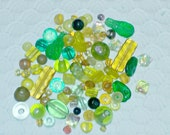 Lot of Various Size and Shape Green, Yellow, and Amber Glass Beads