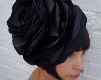 Jet black giant satin rose headpiece fascinator