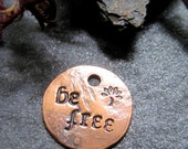 be free - antiqued copper charm or pendant
