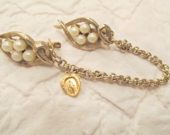 Vintage Sweater Clip faux pearls and religious medal sweater guard