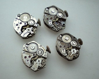 4 vintage steampunk partial watch movements (L36)