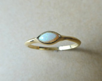 Opal ring. Marquis shaped opal ring. 14k yellow gold opal ring. Opal engagement ring. Opal promise ring.