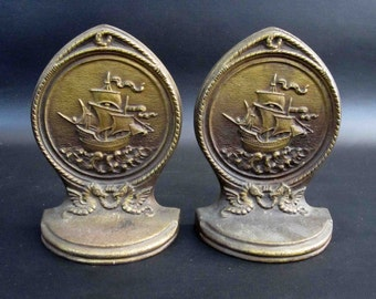 Vintage Bradley & Hubbard Nautical Bookends. Tall Mast Ship with Rigging Ropes and Sea Horses. Circa 1920's.
