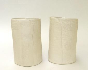 a pair of hand built porcelain vases  ...   cups  ...   matte vessels