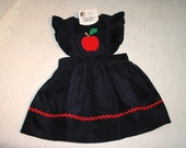 Corduroy Jumper in Pinafore style with apple applique.  Sizes 12 months to 5.  Choice of colors.