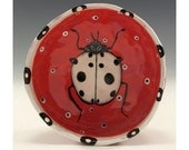 White Lady Bug - Painting by Jenny Mendes in a Red Ceramic Pinched Finger Bowl