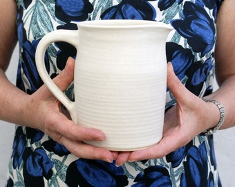 Stoneware pouring jug - wheel thrown and glazed in vanilla cream