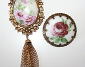 Two vintage goldtone and porcelain flower brooches - one with tassel