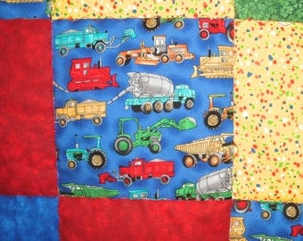 Boy Quilt with Construction Trucks in Blue, Red, Green and Yellow Baby Blanket Nursery Bedding