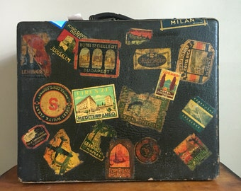 Antique Travelure by Mendel Suitcase with Travel Stickers.