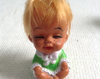 Vintage hard plastic Doll.  Laughing Doll.   So adorable.  4 inches tall.  Made in Korea.