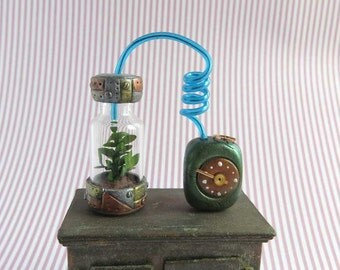 Steampunk hydroponic with power unit and blue hose in 1:12 scale