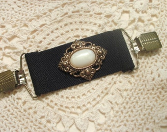 Dress Clip   Wide Black Elastic Band With Large Ornamental Jewelry Center