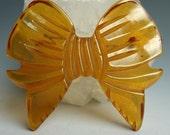 Apple Juice Bakelite Carved Bow Pin