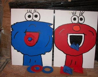 2  games 1  elmo  and   1  google  eyed cookie  with  4  rings and  4  bean  bags