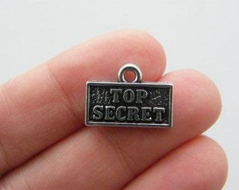 4 Top secret charms antique silver tone G66