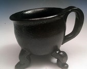 Sturdy Dancing Cauldron Mug looks like cast iron