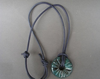 Stoneware Disc Pendant, Glazed in Mottled Blue with a Glossy Finish, on a Round Leather Cord in Dark Purple