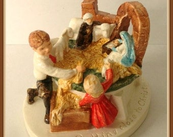 Getting Close to Christmas Figurine, 1983, Sebastian Minature, Setting up Nativity,  by P.W. Baston, Hand Cast, Hand Painted, Hudson, Mass.