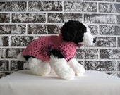 Dog sweater in pink with fur trim in sizes xs, sm.