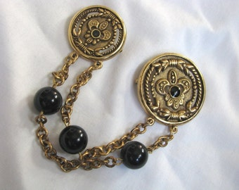 Gold tone chatelaine style brooch pin with black stone accents