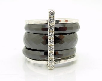 Ceramic stacking ring with zircons set in sterling silver and hammered bands
