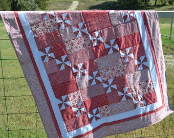 Red and White Pinwheel Quilt