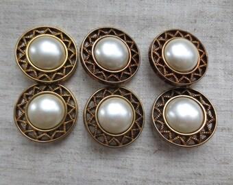 Vintage white faux pearl center gold tone aztec design edge design plastic shank button. Lot of 6 buttons.