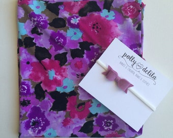 Baby girl swaddle blanket and headband set. Pretty purple and pink floral with a matching wool felt bow