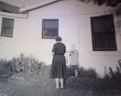 Spooky Bizarre photo Snapshot: Woman and shadow turns her back to the camera 1940s