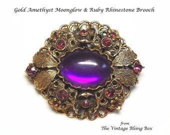 Moonglow Amethyst & Ruby Rhinestone Brooch with Bezel Set Cabochon in Gold Floral Filigree Motif - Vintage Circa 50s Costume Jewelry