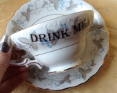 Alice In Wonderland Drink Me Tea Cup and Saucer Set