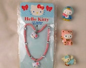 Hello Kitty necklace & 3/Characters Blue Bird, Pink Lamb and Blue Angel
