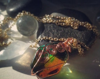 Green and amber wire-wrapped resin pendant