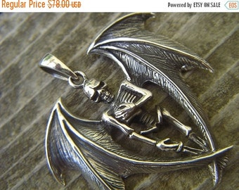 ON SALE Winged skelton pendant in sterling silver