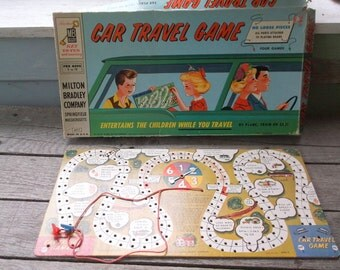 """Vintage Game board and 1 game box top 1958 Car Travel Game board measures 16 x 8"""" and has 2 plastic bus vehicles attached by string"""